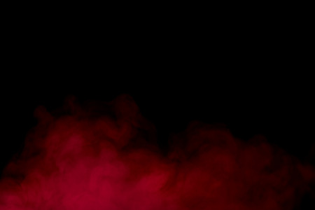 red smoke on a dark background concept of smoking and addiction Banco de Imagens