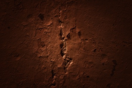 texture of brown wall with flaking filler and pothole grunge grunge background for design