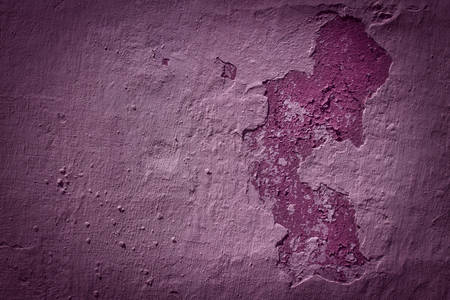bright purple texture of a concrete wall with peeling plaster and dark edges grunge background for design