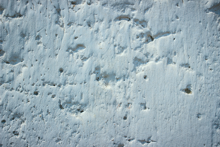 texture of concrete wall with holes and potholes background for design