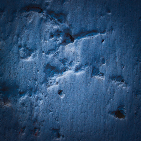 mysterious blue texture of a concrete wall closeup background for design