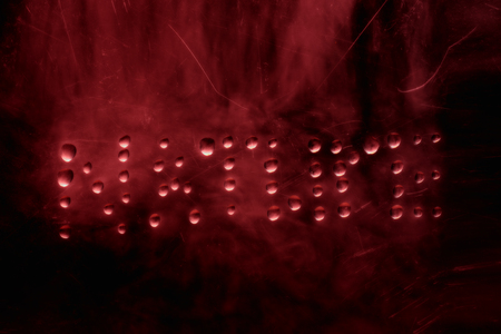 word nature written in drops of water on a mysterious dark background concept of mystic and halloween