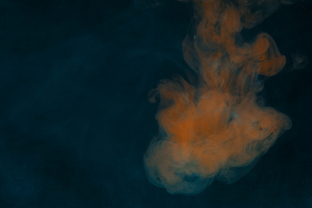 fantastic abstraction under the water orange paint is like a flame exciting chemical process 写真素材