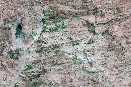 Artistic stone background with cracked hole and peeled plaster background for design