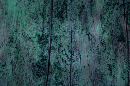 mysterious artistic wood texture with dark edges and bright center of an exciting dark vertical crack natural background for design Standard-Bild