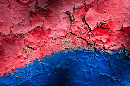 bright and multi-colored metal texture with dark cracks exciting patterns on the old wall grunge background for design Standard-Bild