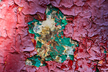 Colorful artistic texture of a metal surface with cracked paint and rust Grunge background for design Standard-Bild