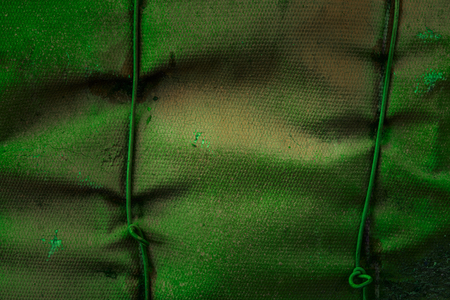 Mysterious green fiberglass texture with metal wires and mint not smooth surface Background for design