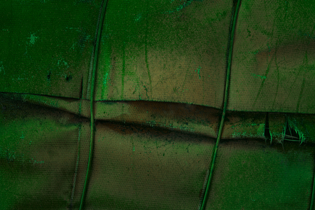 fantastic green texture of old fiberglass covering metal tube mystical industrial background for design Stock Photo