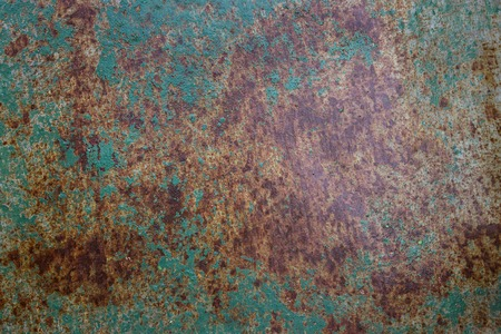 bright texture of aging metal surface covered with rust and a thin layer of paint grunge background for design