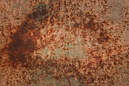 rust mystical patterns covering metal surface close-up grunge background for design