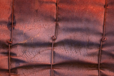Mysterious industrial texture of old and rumpled fiberglass with cracked stains and metal wire Grunge background for the design