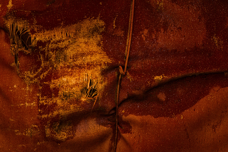 mystical texture of old fiberglass partially torn and metal wire grunge background for design