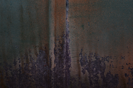 Mysterious metal texture with peeled paint and rust Grunge background for design