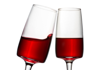two glasses of red wine closeup on a white background bright and beautiful alcoholic drink from grapes