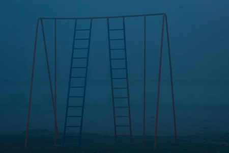 metal sport stairs in the background of thick fog evening stadium nobody around the concept of weather and nature