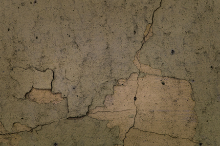 dirty old wall of a building close-up with fine cracks patterns grunge background for design