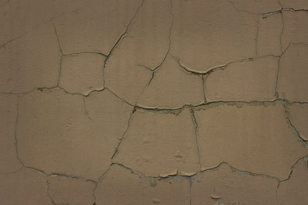 exciting crack patterns on the facade of an old building close-up grunge background for design Standard-Bild