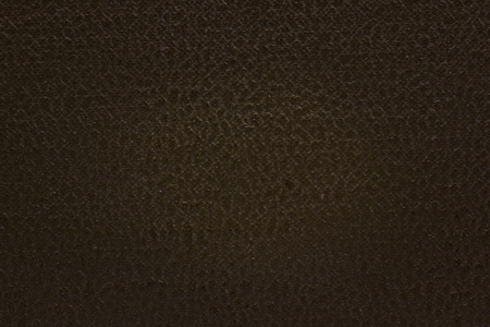 dark brown cardboard texture with patterns and not smooth surface close-up background for design