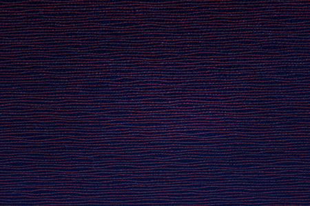 dark blue texture of a cardboard with patterns wavy thin lines close-up background for design