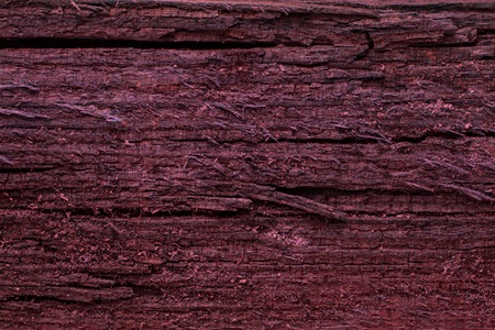 red and mysterious wood texture with dark cracks background for design