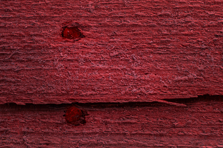 mysterious red wood texture with not smooth surface and metal nails close-up background for design Stock fotó