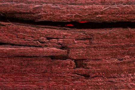 old cracked wooden board closeup red and mysterious with not smooth surface grunge background for design Stock fotó