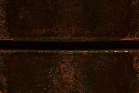 Mysterious rusty steel texture with dark hollow close up grunge background for design Фото со стока