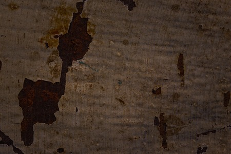 texture of old paint covering a rusty metal surface close-up grunge background for design