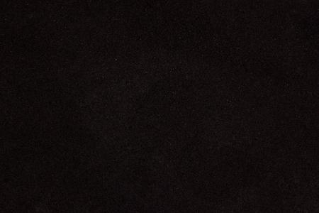 dark sandpaper surface texture closeup industrial mysterious background for design Standard-Bild
