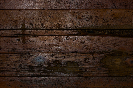 Mysterious texture of old wooden floor with scratches cracks and defects Grunge background for the design