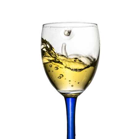 storm in a glass with white wine breathtaking splash beautiful shiny bubbles object for design concept alcohol drinks 免版税图像