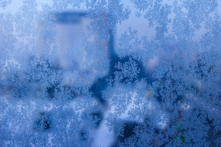 beautiful patterns on the window in winter exciting snowflakes background for design