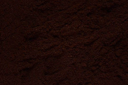 texture of not smooth surface of dark ground coffee background for design concept of hot drinks Imagens