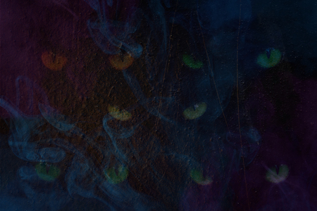 ghostly menacing eyes blue transparent steam on the background of rusty metal close-up mysterious abstraction