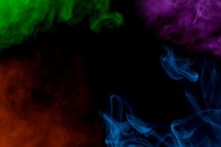 incredible multi-colored patterns of cigarette vapor mystical clouds along the edges of the frame on a dark background abstraction for design concept of smoking