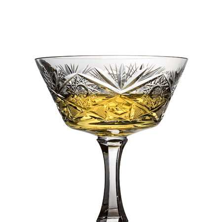 white wine in vintage crystal glass with patterns isolated on white background object for design concept of alcoholic beverages 写真素材