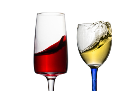 exciting waves of red and white wine in different elegant glasses close-up object for design alcohol concept