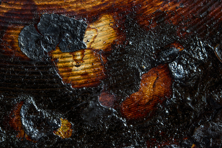 exciting black patterns on the surface of burnt metal close-up grunge background for design