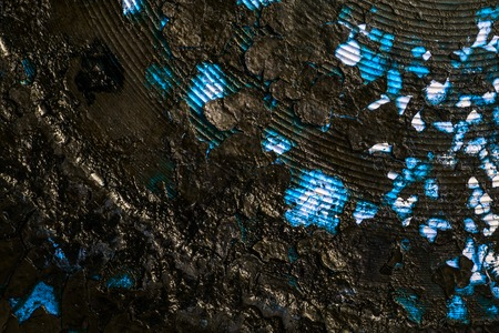 mystic texture abstraction blue shiny metal covered with a black cracked layer of soot background for design Stock Photo
