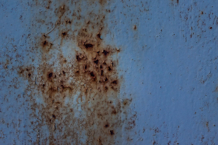 blue metallic texture with partially peeled paint and rust abstraction for design industry concept