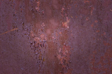 old rusted sheet of metal with partially peeling paint and exciting patterns close-up grunge background for design industry concept