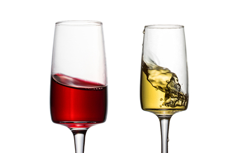 delicious and bright drink red and white wine in charming transparent glasses close-up objects for design alcohol concept 免版税图像