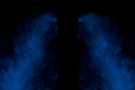 two symmetrical streams of a thick blue cigarette and mystical exciting patterns on a dark background abstraction for design smoking concept