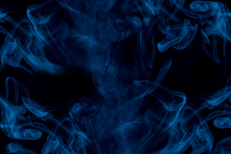 ghostly and misty blue cigarette vapor thick and transparent cloud on a dark background abstraction for design smoking concept