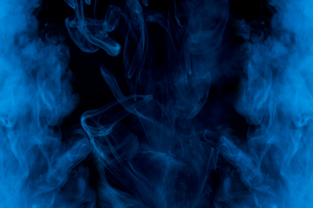 mysterious and ghostly blue cigarette vapor with exciting patterns bewitching abstraction for design is bright and beautiful