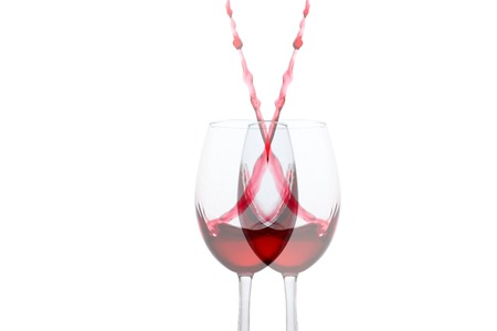 split red wine glass with symmetrical high bursts close-up on a white background object for design alcohol concept