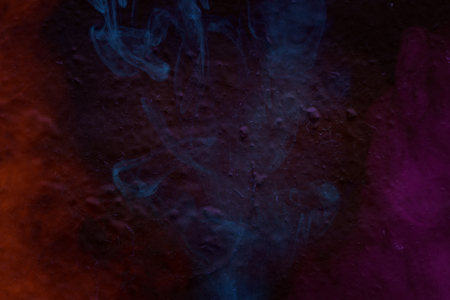 ghostly clouds of multi-colored cigarette vapor on the wall of a building close-up artistic abstraction for design Stockfoto