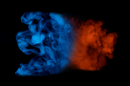 red-orange pattern cloud of cigarette vapor on a dark background color concept smoking abstraction for design Stock Photo