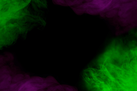 purple and bright green and mysterious cigarette vapor on a dark background at the edges of the frame